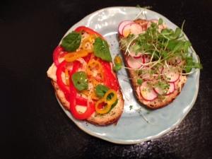 hummus veggie radish sprout sandwich